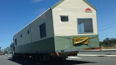 Multi-purpose shed being delivered